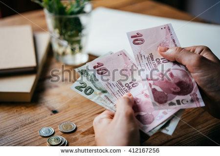 stock-photo-hands-holding-turkish-lira-bills-412167256
